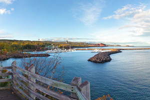 Photo of the Silver Bay Marina, where you can paddle past rugged shoreline hiding a glimpse of a historic shipwreck.