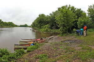 Photo of canoes on the shore of Vicksburg County Park.