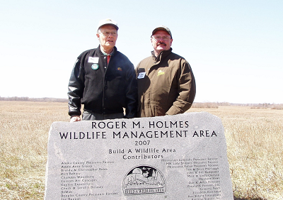 Holmes on left with Joe Duggan of Pheasants Forever at the dedication of the Roger Holmes Wildlife Management Area in May of 2008.