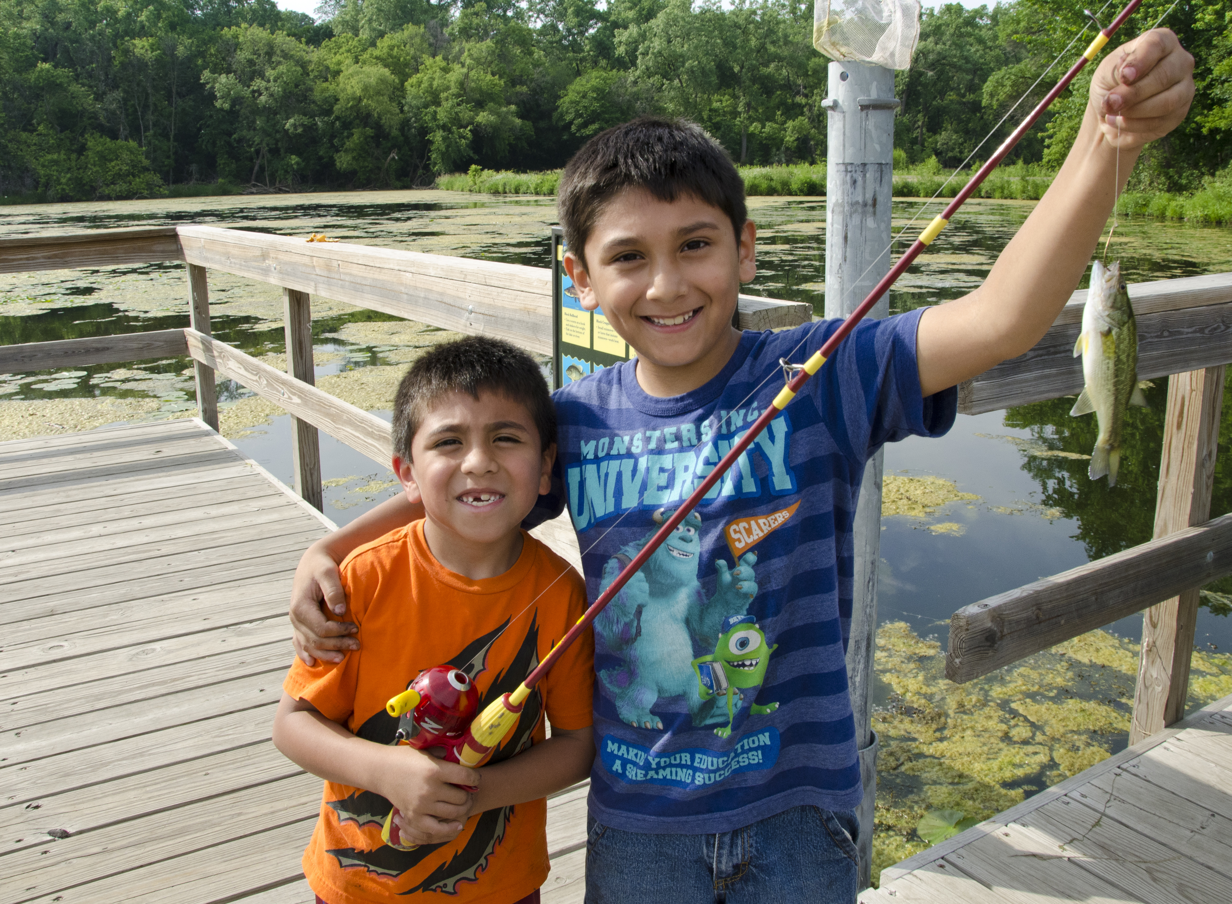 Two boys smiling during a Fr. Snelling fishing outing