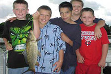A group of kids with one holding a fish