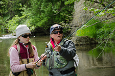 A mentor and mentee fly fishing