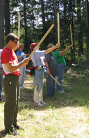 Photograph of students using sticks