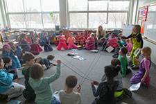 student in a classroom sitting in a circle