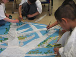 photo: student painting poster