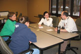 photo: School Forest committee meeting around a table