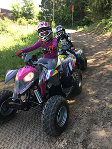 children riding atvs