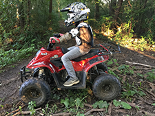 child riding atv