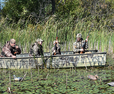 waterfowl hunters in a duck blind with decoys