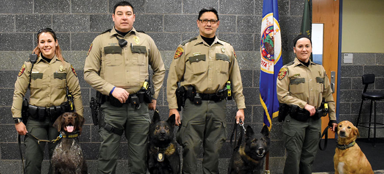 DNR K9 Unit - photo of officers with their dogs