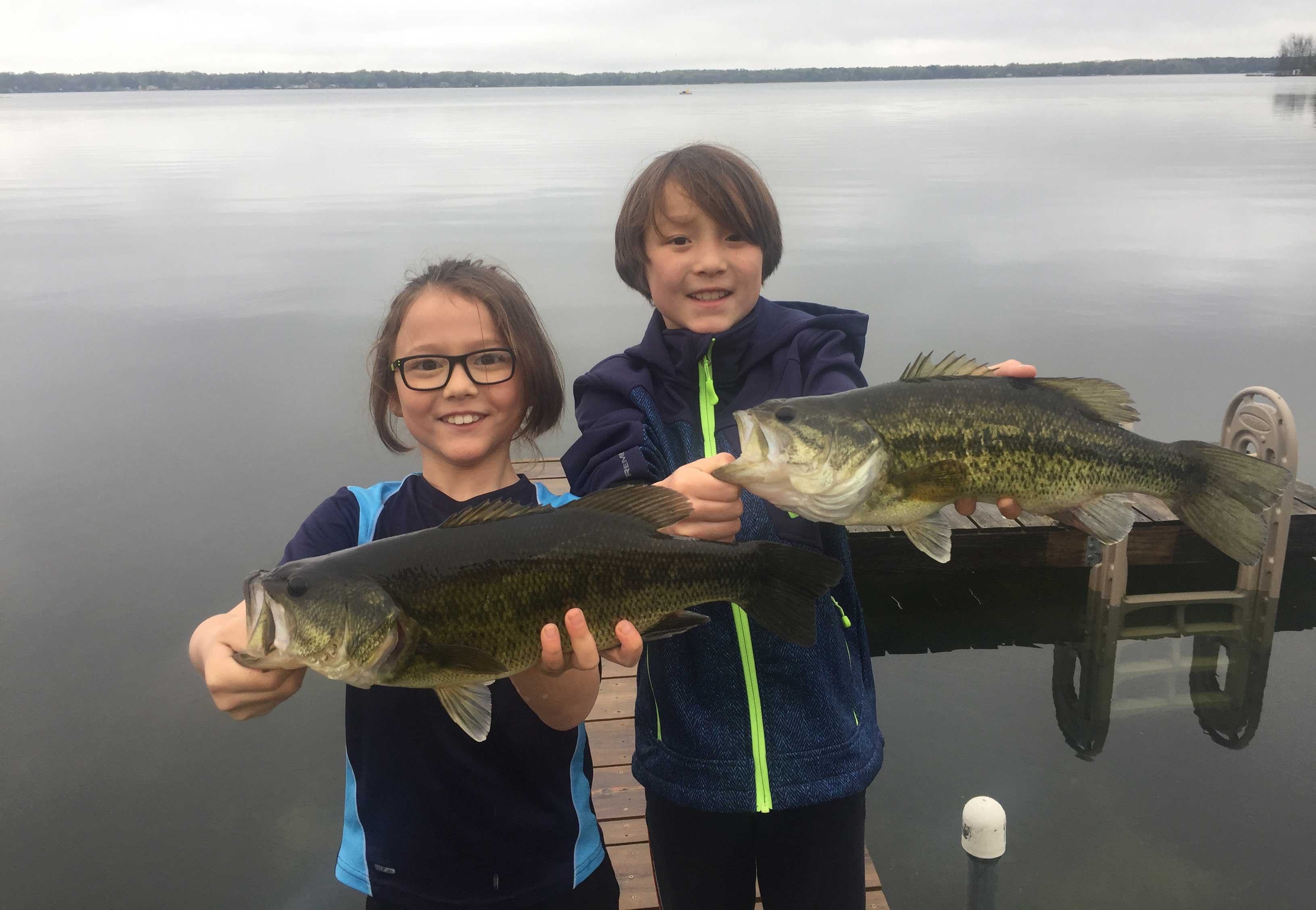 kids holding bass they caught