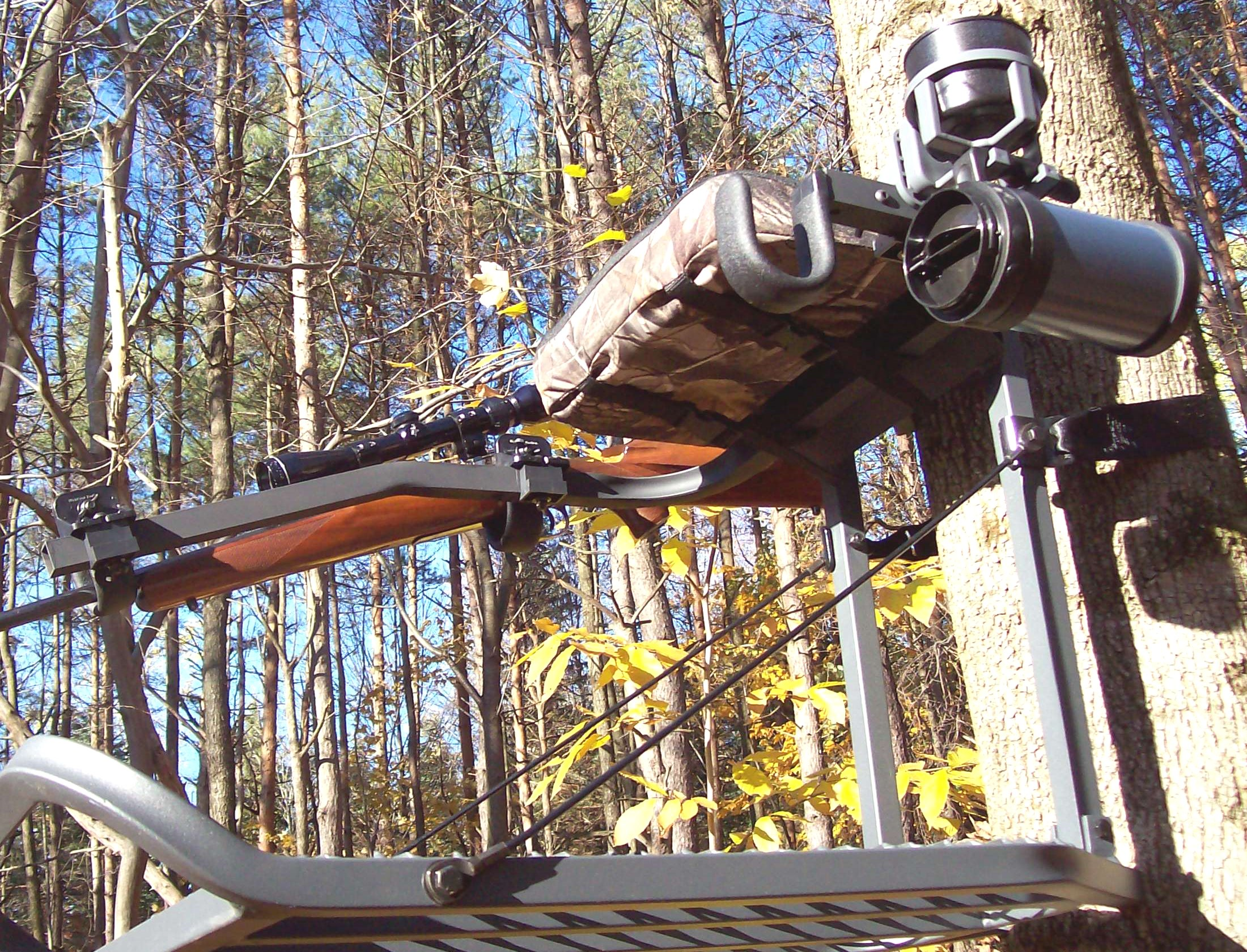 Portable tree stand mounted on a tree in the woods for deer hunting