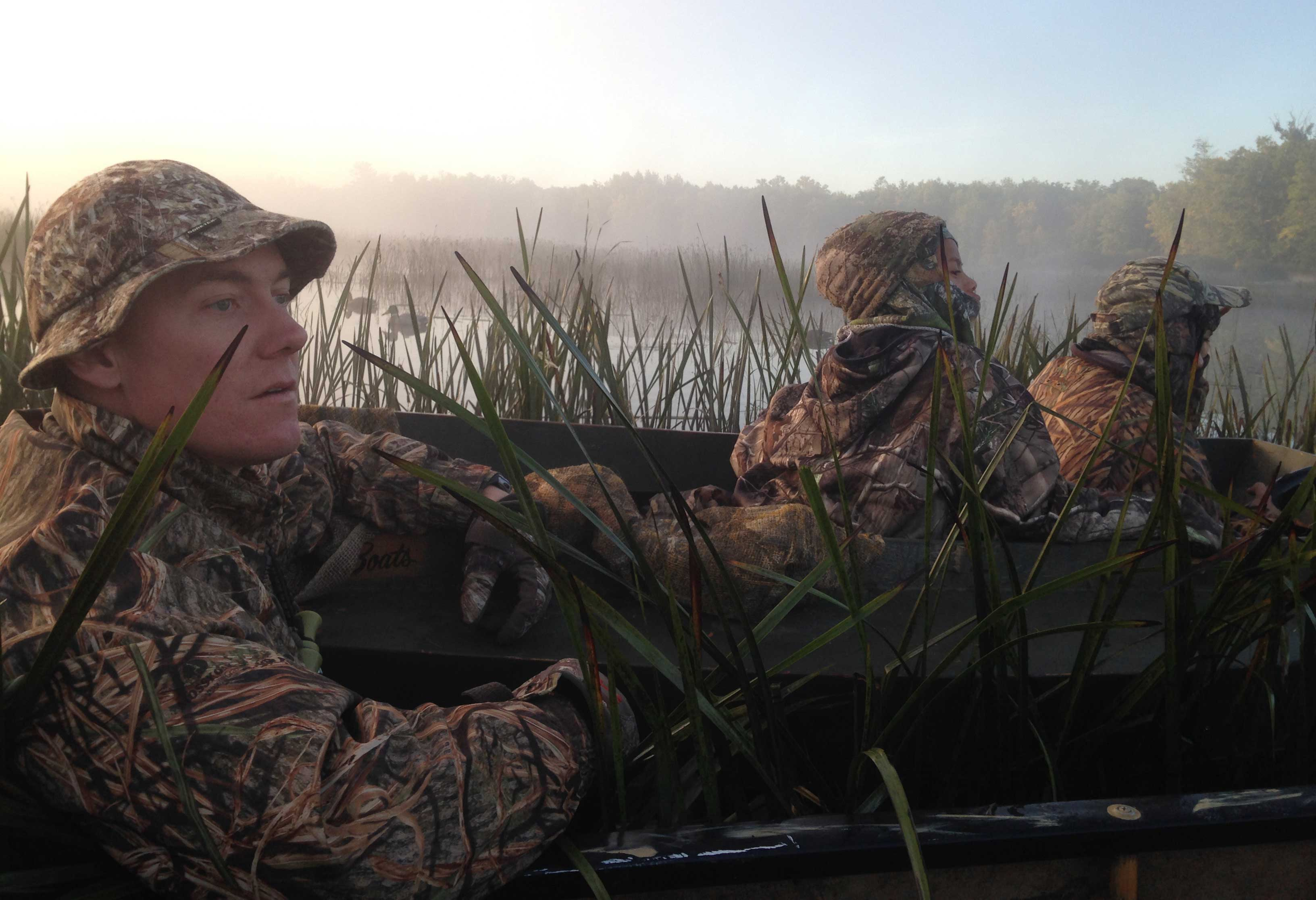 Two youth and an adult mentor hunt during the youth waterfowl hunt
