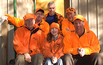A multi-generational friends and family portrait taken at a Minnesota deer camp