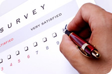 Closeup of hand checking boxes on a survey