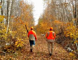 Hunters walking along a hunting trail