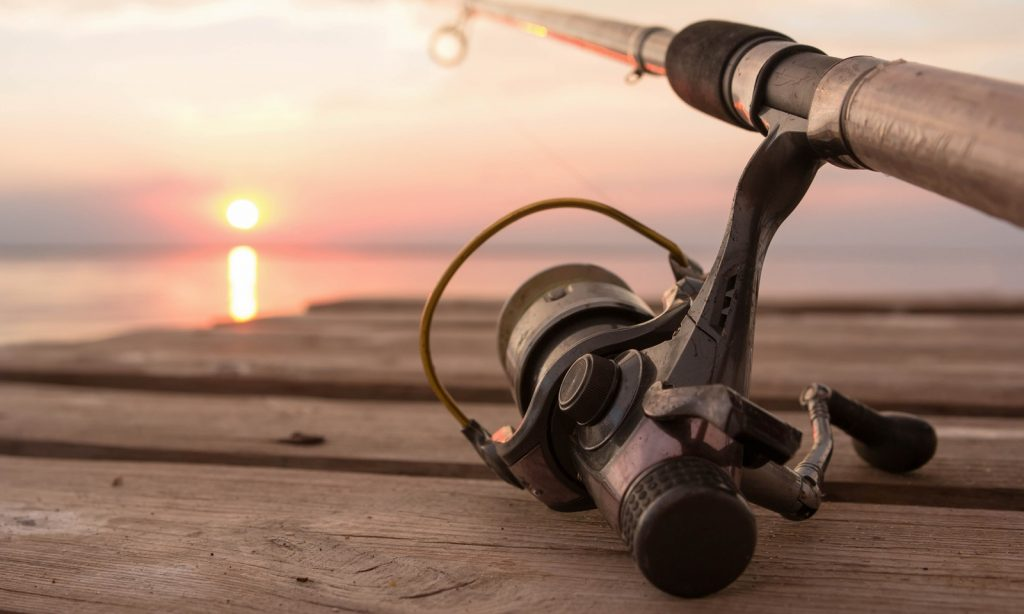 Fishing rod and reel sitting on a dock