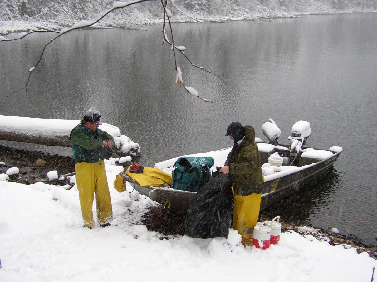 A Grand Marais crew pepares to portage lake trout eggs out of Mountain Lake. The eggs supply trout stocking programs throughout Minnesota.