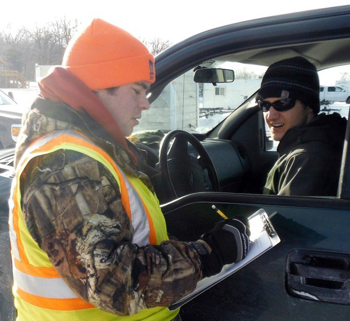 Collecting catch information from anglers during a winter creel survey on Leech Lake.