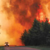 Brainerd By-Pass Fire 2002, May 31. 720 acres burned, 0 lives lost. Image of the fire racing down the road.