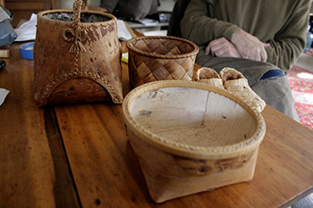 three various backets made from birch bark