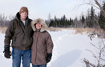 Deb Pomroy and Ray Barnes standing in snow covered field