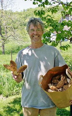 Larry Gates holding a basket of morel mushrooms
