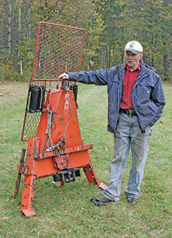 Patrick Lanin standing by farm winch
