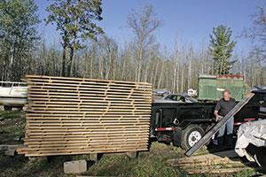 John Wallin by his wood pile