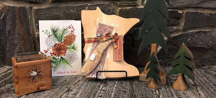 Wooden gift ideas. Candle holder, card, cutting board, and pine trees.
