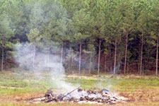 an image of large debris pile on a slow burn