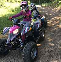 kids riding atvs