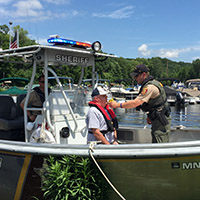 checking boater with breathalizer