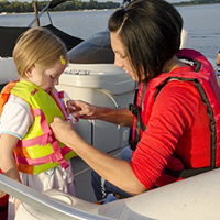 fitting a child's life jacket