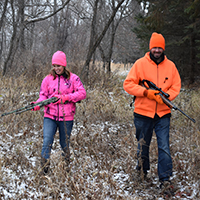 hunters in pink and orange