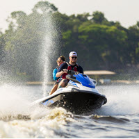 people on a personal watercraft