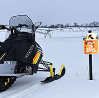 sign on snowmobile trail