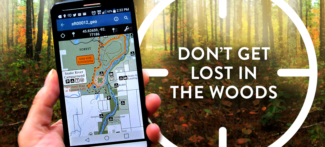 GeoPDF - don't get lost in the woods. Hand holding a cell phone with a geoPDF on the screen.