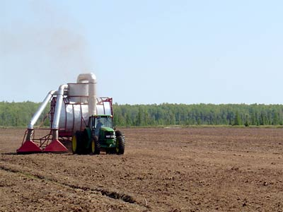 Vacuum harvester operating at a peat mining operation near Cromwell, MN