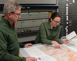 DNR staff members looking at a map of state lands and resources