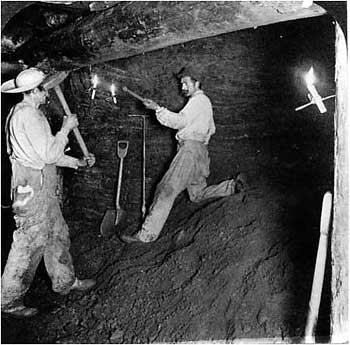 Miners at work in an underground drift