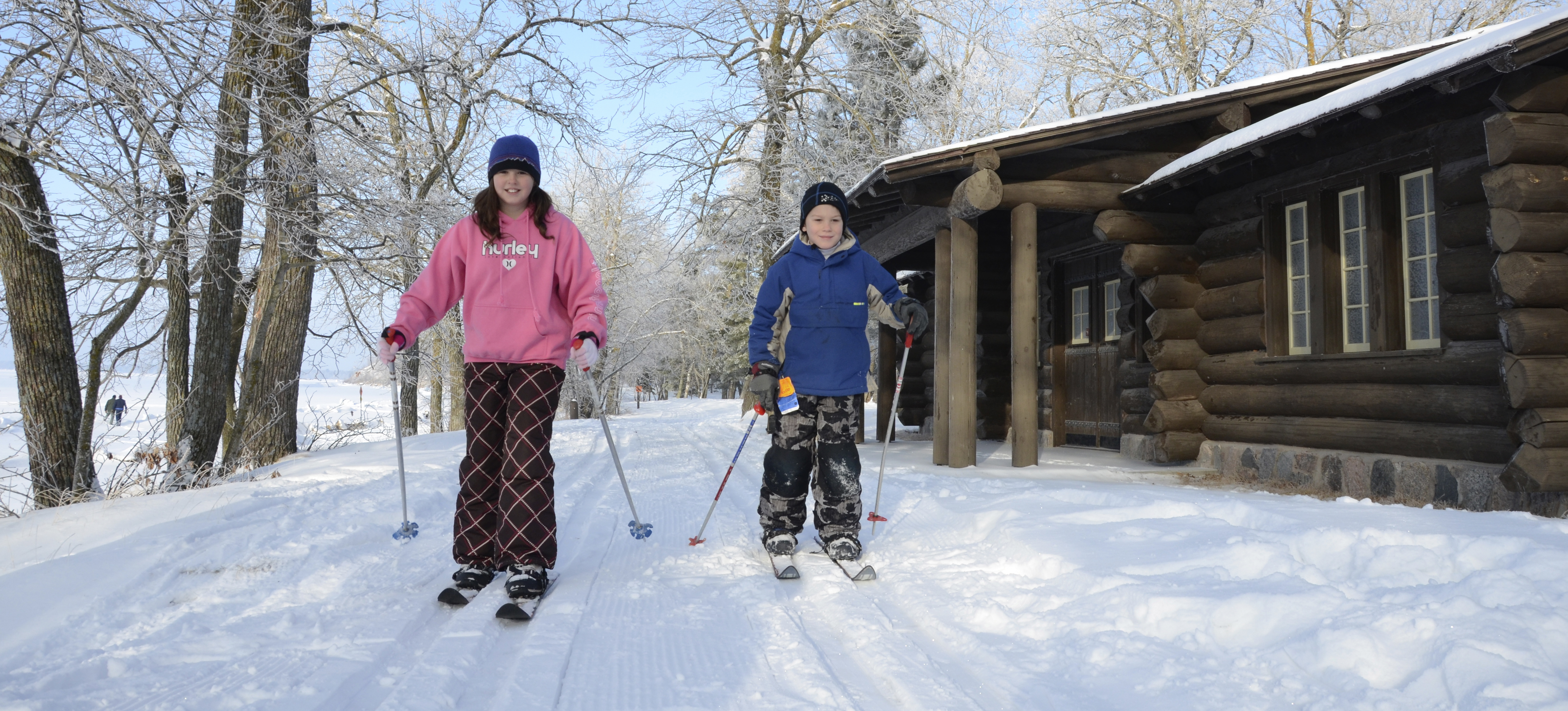 two children cross country skiing