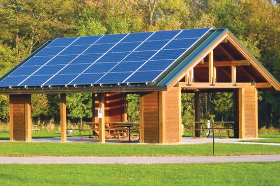 a visitor shelter with solar panels at a state park