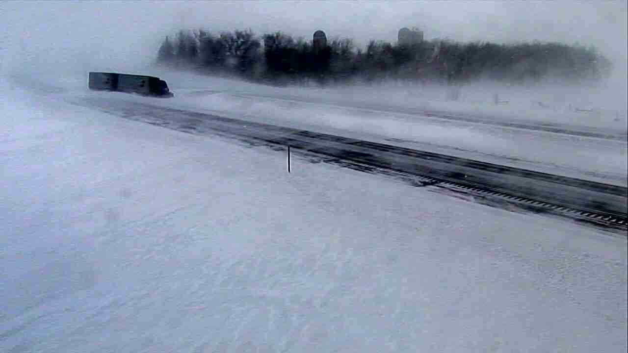 Semi-trailer truck stuck in snow on I-90 near Lakefield in Jackson County