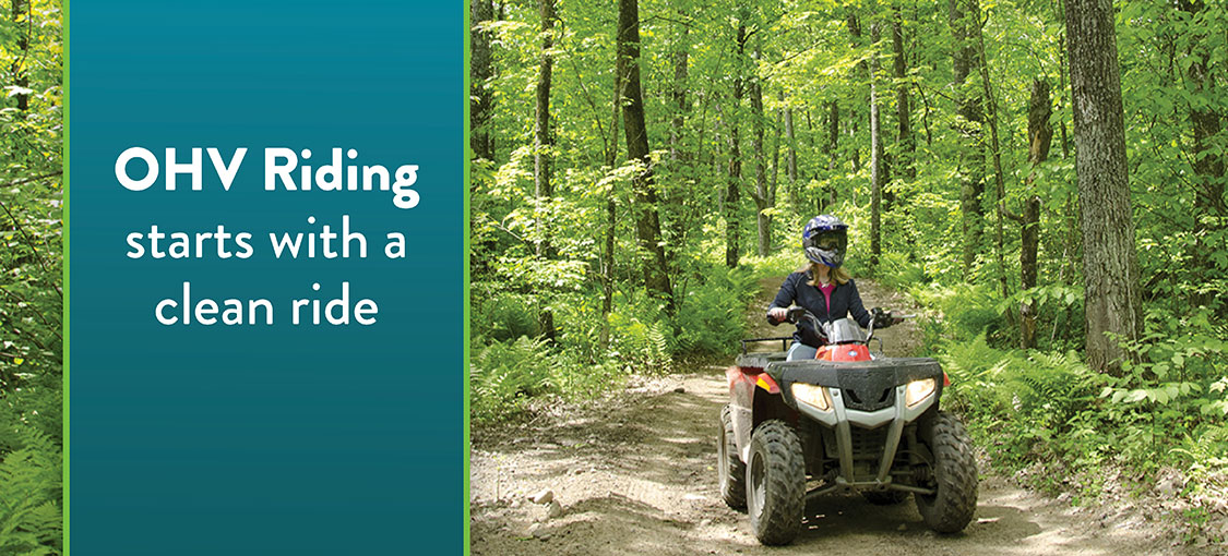 two people rding atvs on trail.