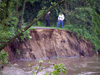 Staff inspecting washed out trail