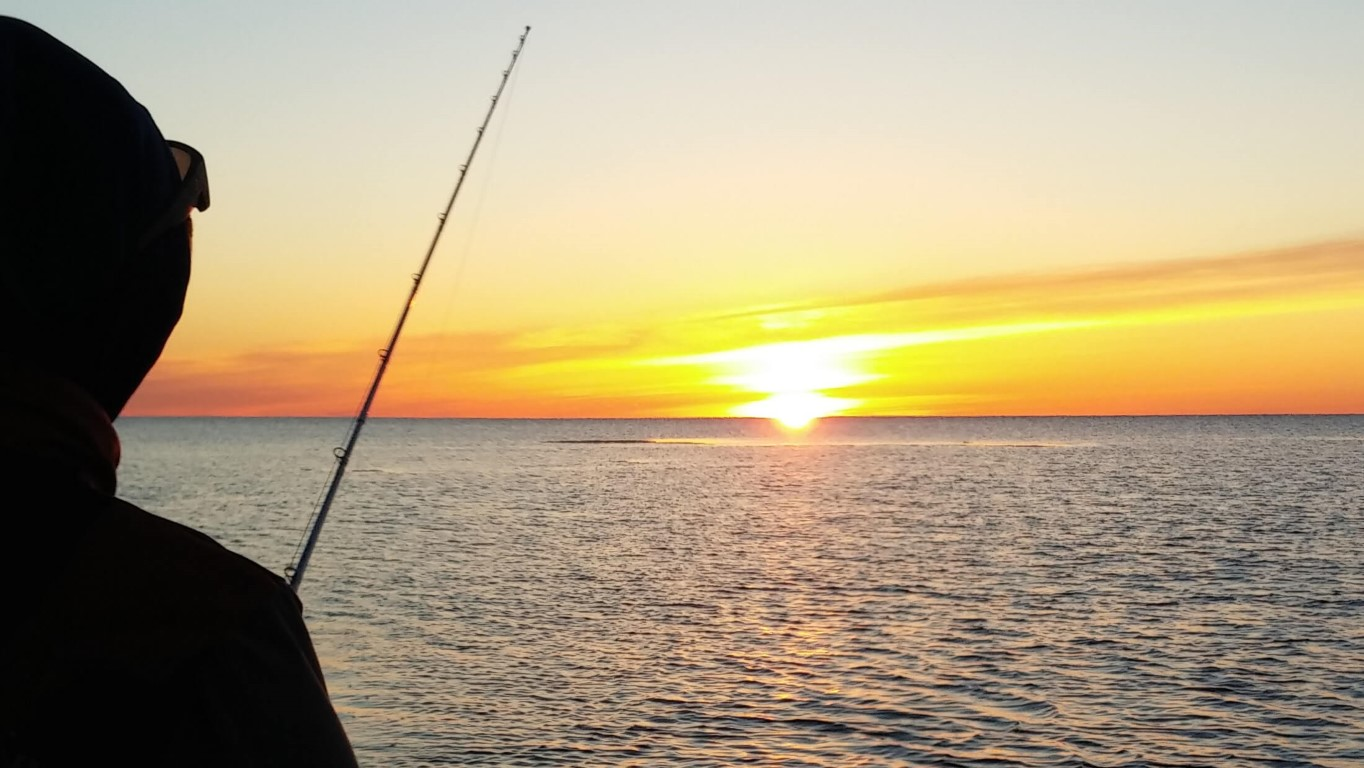 An angler trolling for lake trout on Lake Superior