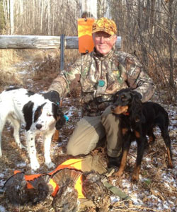 Grouse, gun and dog