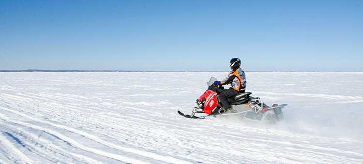 snowmobiler on Lake Mille Lacs