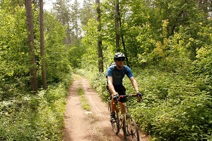 bicyling on trail in woods